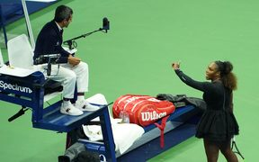 Serena Williams argues with chair umpire Carlos Ramos while playing Naomi Osaka during their 2018 US Open women's singles final match.