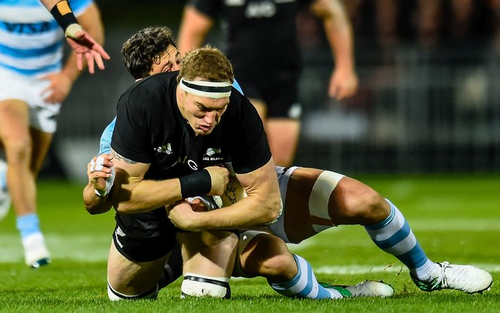 Brodie Retallick of the All Blacks gets hurt in a tackle against Argentina