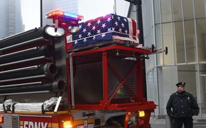 One of the caskets carrying the remains of those killed the September 11, attacks sits is returned to Ground Zero in New York.