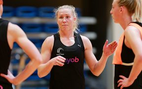 Laura Langman in a team discussion with defenders during Silver Ferns training