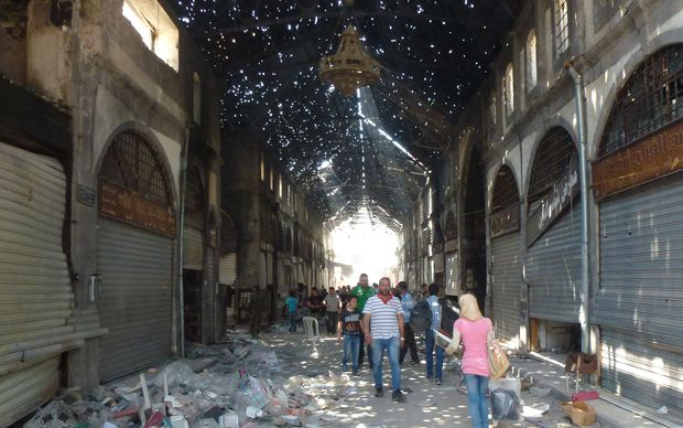 Civilians in the Souk Maskouf in Homs on Saturday after rebels left the old city.