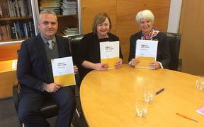 Minister for Energy and Resources Megan Woods (centre) with the first phase of the Electricity Price Review.