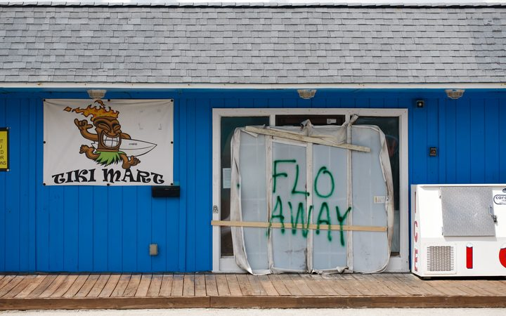 A Tiki bar sits empty with a message for Hurricane Florence on Topsail Island, North Carolina.