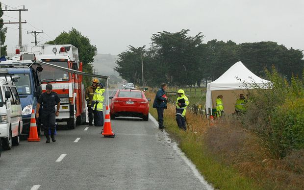 Police and firefighters at the site of the balloon crash on 8 January 2012.