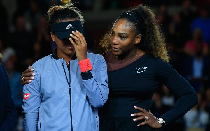US Open winner Naomi Osaka is comforted by runner up Serena Williams during the trophy presentation