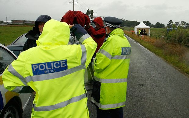 Policemen at the site of the crash near Carterton in 2012.