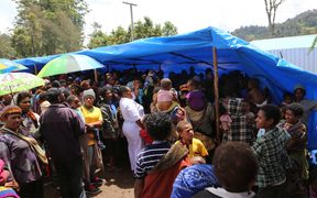Polio has been confirmed in Enga province, prompting a large containment, monitoring and vaccination campaign. Here, a crowd gathers for vaccines.