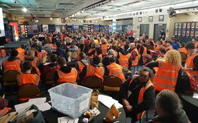 Hundreds of volunteers are given a briefing at Eden Park, one of five hubs for the census of the region's homeless