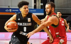Tall Blacks Tai Webster fends off  Lebanon's Elias Ruston during the Tall Blacks win over Lebanon in Rotorua.