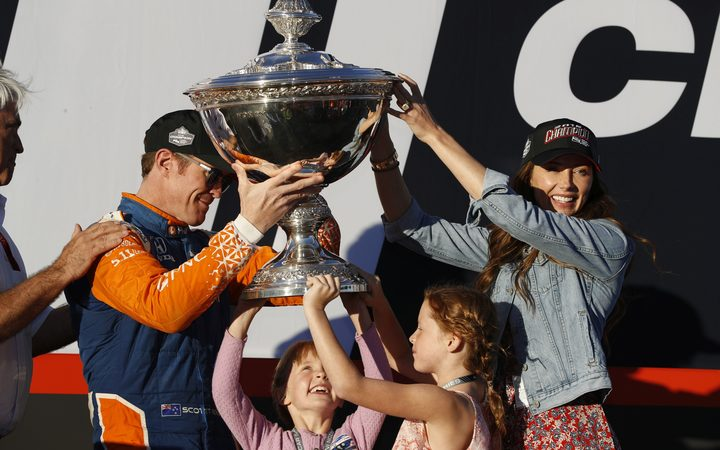 Scott Dixon celebrates his fifth Indycar championship win wife Emma and daughters Poppy and Tilly