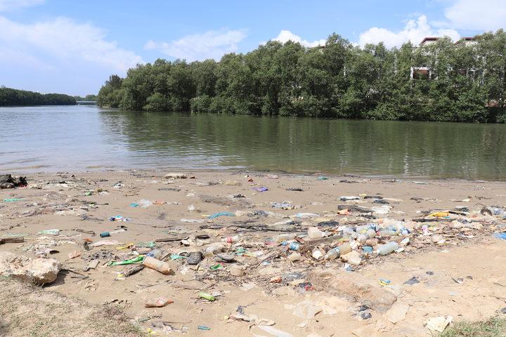Plastic waste litters a river near Kota Kinabalu.
