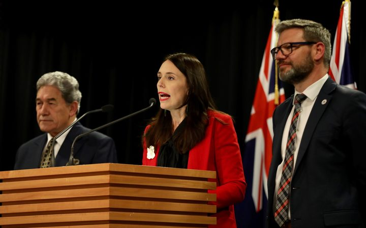 Prime Minister Jacinda Ardern - flanked by deputy PM Winston Peters and Immigration Minister Iain Lees-Galloway - announces the increase in NZ's refugee quota.