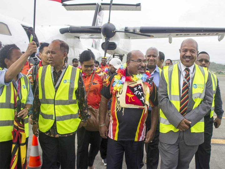 From left: Indonesian ambassador to PNG, His Excellency Ronald Manik, Governor Enembe, Governor Parkop and others walking out of the tarmac at Jackson's International Airport in Port Moresby.