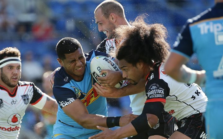 Moeaki Fotuaika carries the ball for the Gold Coast Titans during a July game against the Warriors