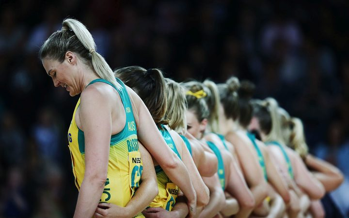 Caitlin Bassett of Australia lines up with the team during the national anthems.