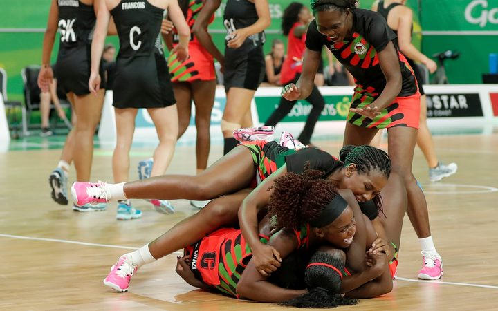 Malawi celebrate their upset win over the Silver Ferns at the Gold Coast Commonwealth Games.