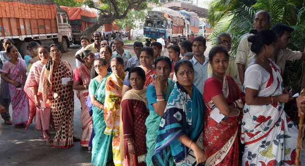 Voters waiting to cast their vote in Kolkata on Monday.