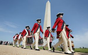 Members of the US Army Old Guard Fife and Drum Corps march parade in front of the Washington Monument on Monday.