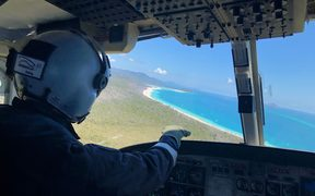 The RACQ CQ Rescue helicopter on the flight to rescue a shark victim at the Whitsunday Islands in Australia.