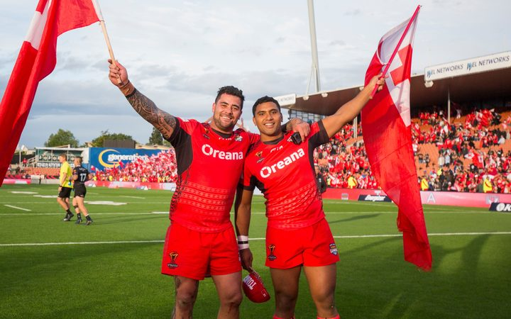 Andrew Fifita, (left) and Tevita Pangai Junior celebrate a win during the 2017 World Cup