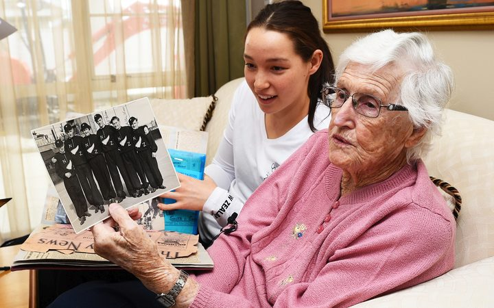 New Zealand's oldest living Olympian 92 year old Ngaire Galloway and granddaughter Gina Galloway look over 1948 Olympic memorabilia.