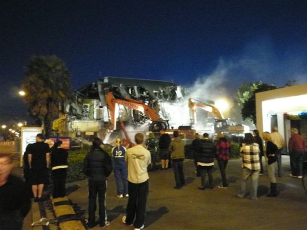 Onlookers watch as the Carlton Hotel comes down (Tim Graham)