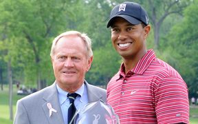 Tiger Woods celebrates a tournament victory alongside fellow golf great Jack Nicklaus.