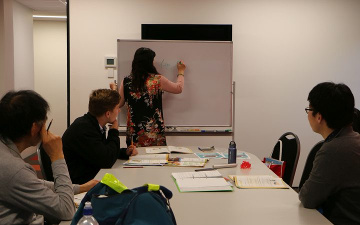 Waitsu Wu teaches her Mandarin Chinese class.
