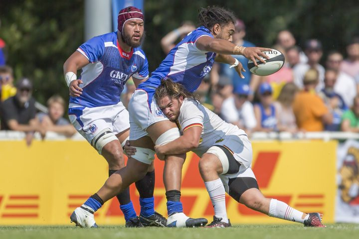 Chris Vui is tackled during Samoa's Rugby World Cup qualifying victory against Germany.