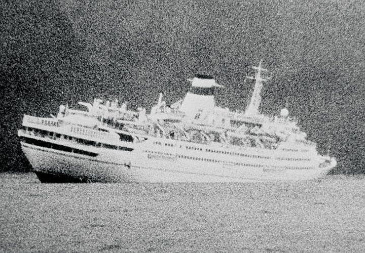 EP/1989/1713/4 Soviet cruise liner the Mikhail Lermontov sinking in the Marlborough Sounds, taken ca 16 February 1986 by the skipper of a fishing boat.