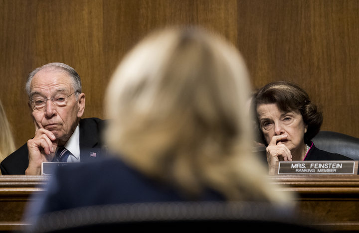 Republican Senator Chuck Grassley and Democratic Senator Dianne Feinstein listen to Christine Blasey Ford testifying during the Senate Judiciary Committee hearing on the nomination of Brett Kavanaugh the Supreme Court.