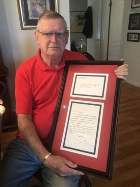 Thomas Meehan, father of Colleen Barkow who was killed in the World Trade Centre attack, with his letter from President Obama.