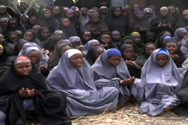 A screengrab from the Boko Haram video of shows girls, wearing the full-length hijab and praying in a rural location.