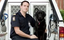 Detector dog Kane and his handler Senior Customs Officer Robert Gillanders.