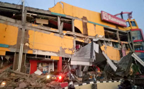 A collapsed shopping mall in Palu, Central Sulawesi after a 7.5 magnitude earthquake hit the area.