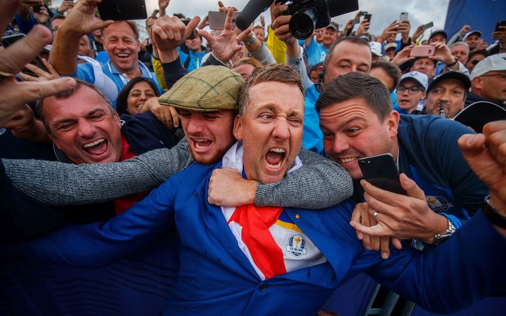 Ian Poulter celebrates winning the 2018 Ryder Cup with fans