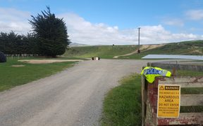 The entry to the North Otago farm where a mother and her young son died when the tractor they were on slipped into a reservoir.