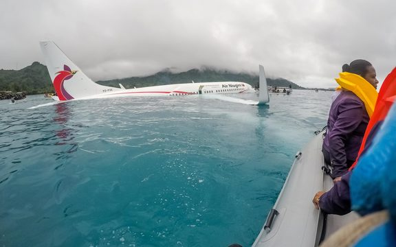 The Air Niugini plane after it crashed into the sea short of the runway at Chuuk, in Federated States of Micronesia.