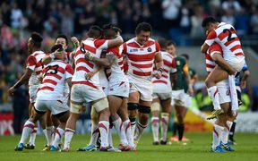 Japan celebrate their shock victory over the Springboks at the World Cup in 2015.