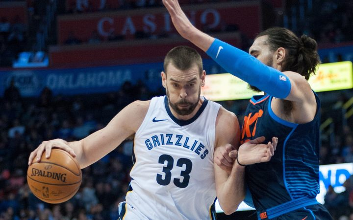 Memphis Grizzlies Center Marc Gasol  driving to the basket while Oklahoma City Thunder Center Steven Adams  plays defense.