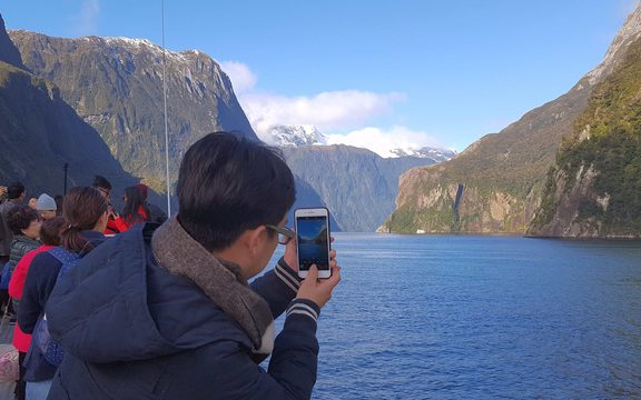 Tourist in Milford Sound