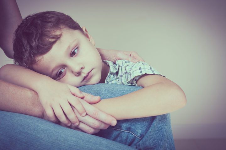 49451379 - A photo of a sad son hugging his mother at home. concept of couple family is in sorrow.
