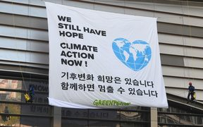 "Greenpeace activists display banner reading ""We still have hope, Climate action now!"" prior to a press conference of the Intergovernmental Panel for Climate Change (IPCC) at Songdo Convensia in Incheon on October 8, 2018."