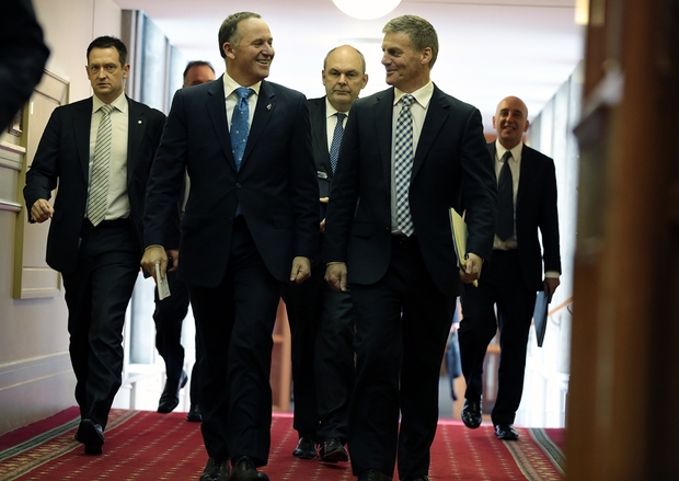 John Key and Bill English walk towards the debating chamber at Parliament.