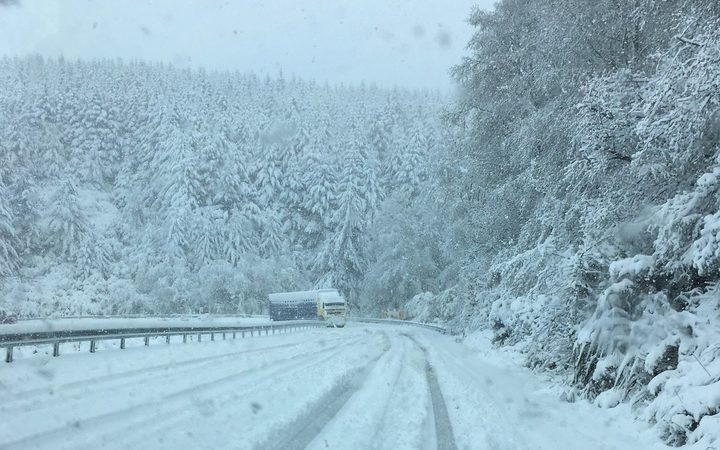 A truck on the snow-covered Blackmount-Redcliff Rd, near Monowai, Southland.