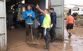 Rafa Nadal helps clear up after flooding in Majorca.