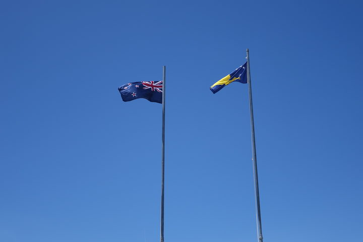 Tokelau and New Zealand flags flying in Atafu, Tokelau