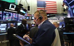 Traders on the floor of the New York Stock Exchange (NYSE) on October 4, 2018 .