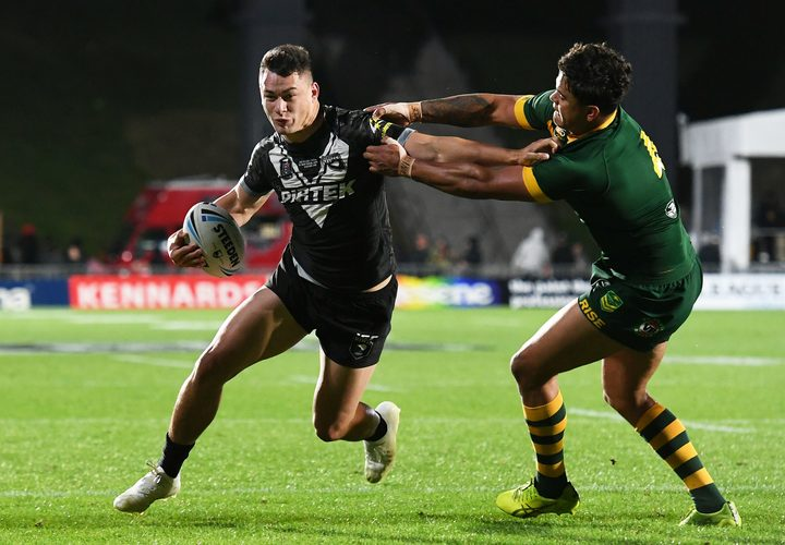Young Kiwis star Joseph Manu puts a fend on Kangaroos opposite and Roosters team-mate Latrell Mitchell.