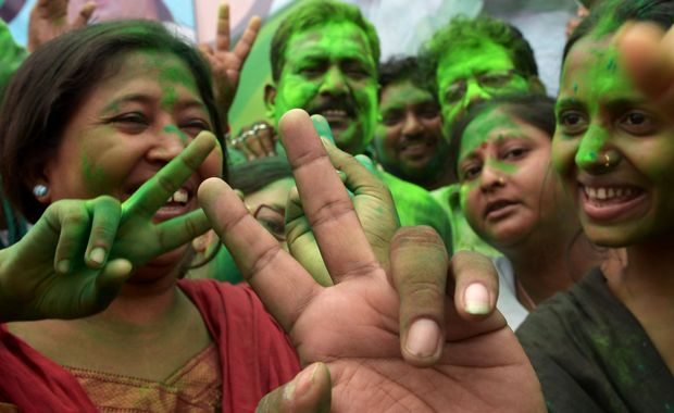 Supporters of Trinamool Congress (TMC) celebrate election results near the house of party supremo and chief minister of eastern West Bengal state.